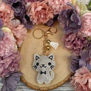 White Rhinestone Cat with a Tassel on a Keychain